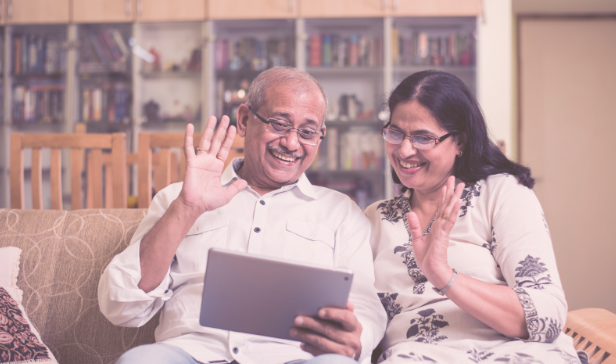 elderly indian couple looking through parentcare website on a tablet