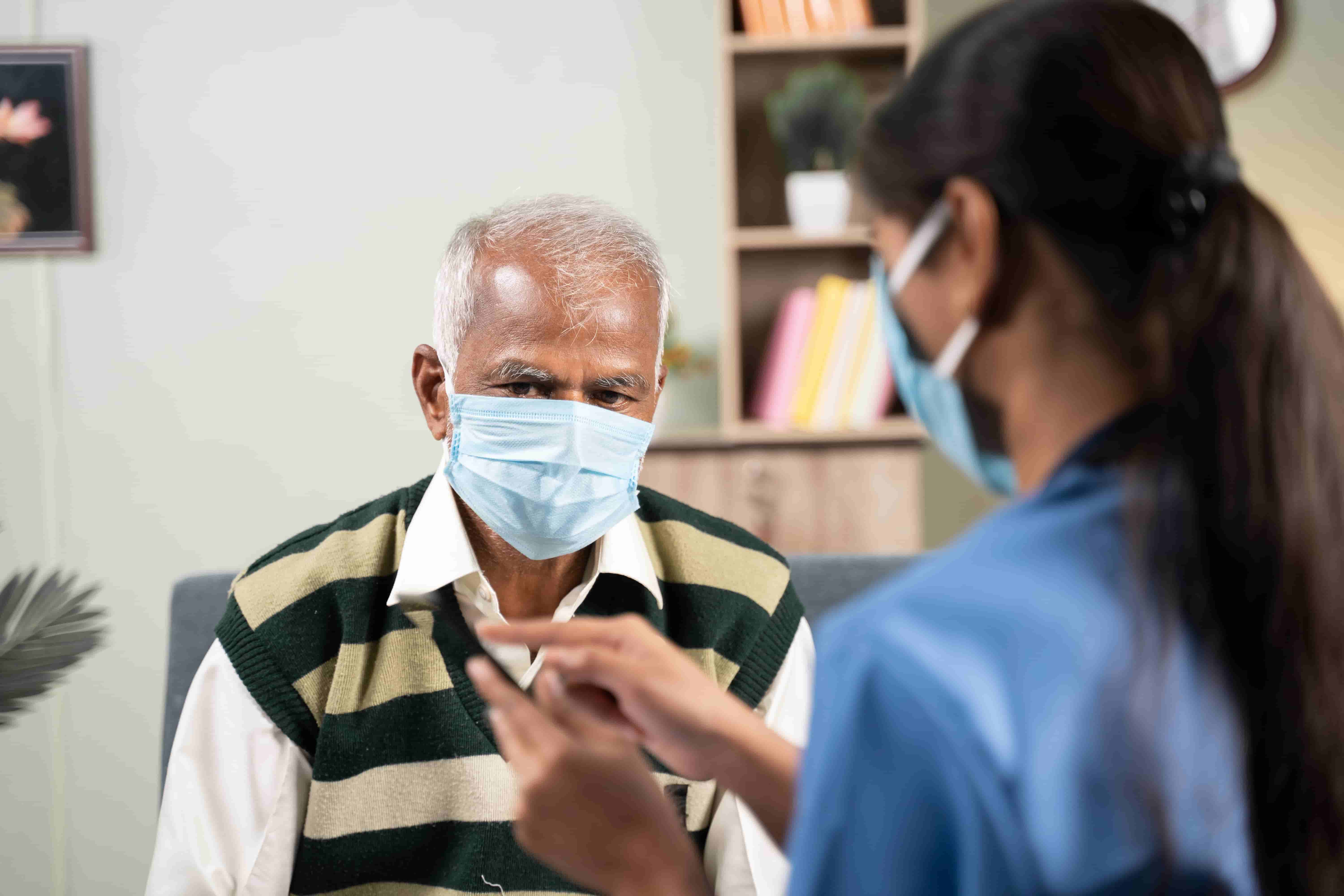 a female homecare nurse with an elderly patient